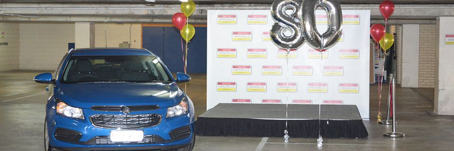 Community Gathers For Henzells Car Giveaway
